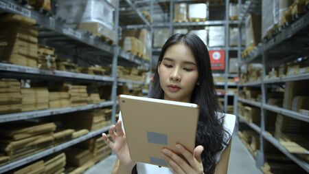 Shopping concept. Young women searching for goods in the warehouse. 4k Resolution. Stockfoto