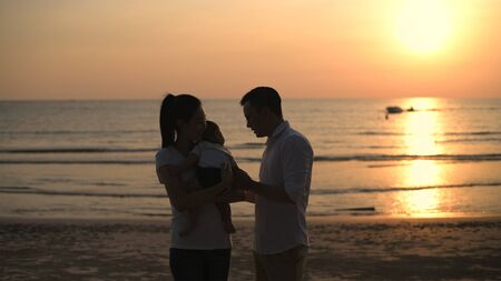 Family concept. Parents raising children on the beach. 4k Resolution.