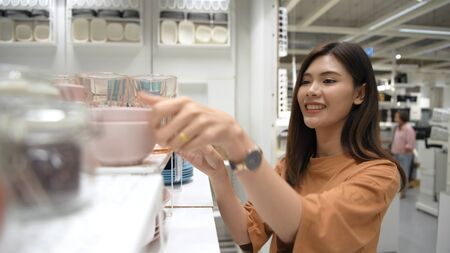 Shopping concepts. An Asian woman is buying a container in the mall. 4k Resolution.