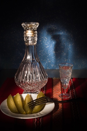 still life with glass and a decanter photo