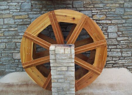 water wheel: Water Wheel and Rustic Building Stock Photo