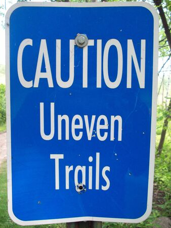 Caution Uneven Trails Sign