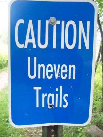 trail sign: Caution Uneven Trail Sign