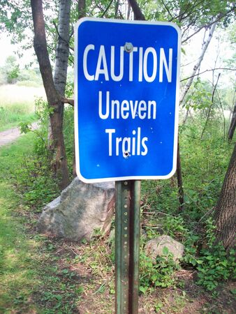 uneven: Caution Uneven Trails Sign