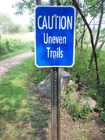 Caution Uneven Trails Sign