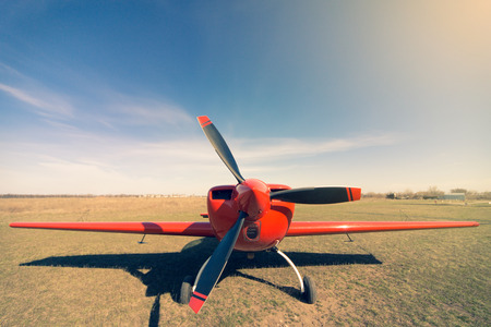 airplane ultralight: Red sport aircraft Stock Photo