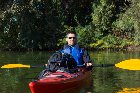 paddler: The man is kayaking on the river. Stock Photo