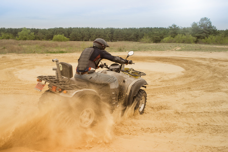 supercross: Racing ATV is sand. Stock Photo