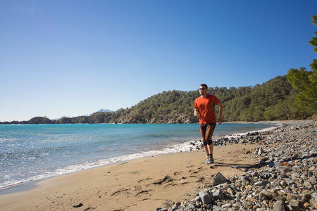 beautiful location: Running man in the summer in a beautiful location.