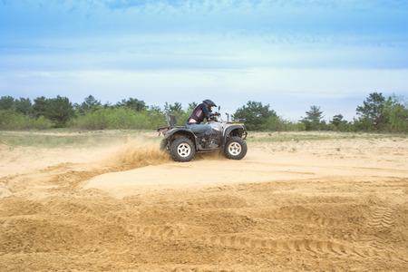 powerfull: Racing ATV is sand. Stock Photo