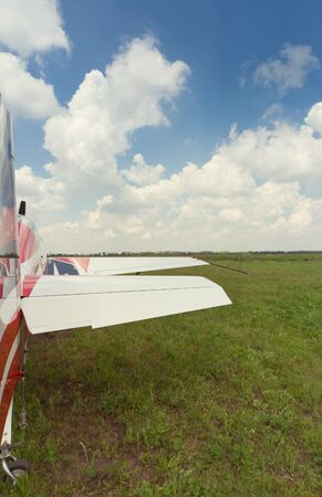 airplane ultralight: The aircraft is standing on the grass against the blue sky. Stock Photo