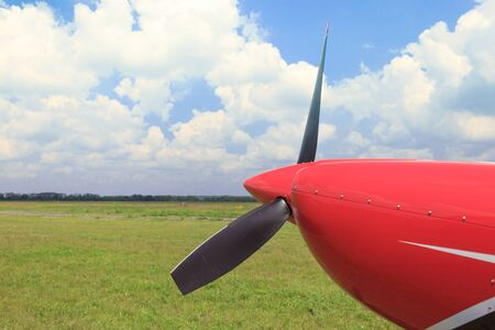 airplane ultralight: The plane is at the airport against a beautiful sky.