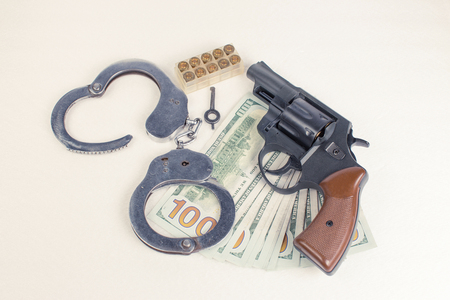 ammo: Pistol, handcuffs ammo and money on a white background. Stock Photo