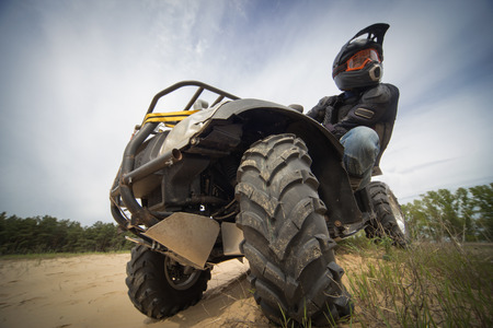 supercross: Racing ATV on the sand in summertime.