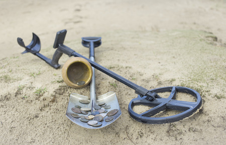 hidden success: Search for treasure using a metal detector and shovel. Stock Photo