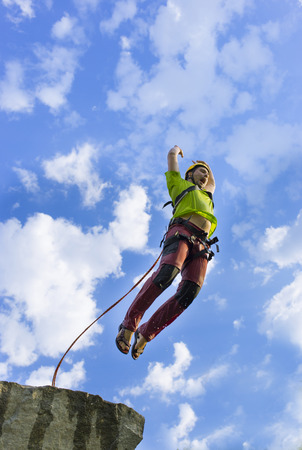 freefall: The first jump off the cliff with a safety rope.