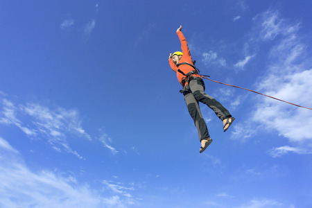 The first jump off the cliff with a safety rope.
