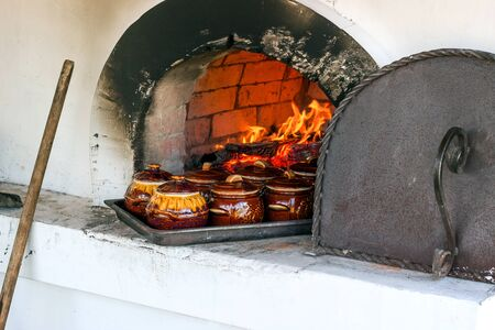woodburning: wood-burning stove with food in pots Stock Photo