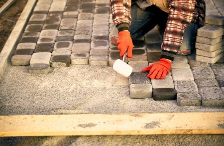 coverings: Construction of road coverings of blocks on the road section. Stock Photo