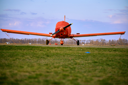 Small  aircraft with a propeller in the parking lot of the airfield. Stock Photo