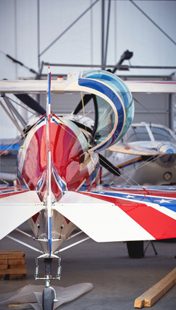 airplane ultralight: A sports aircraft in a hangar for service in the summer. Stock Photo