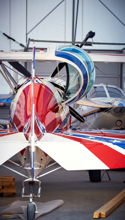 airplane ultralight: The tail of a sports aircraft in a hangar on the service.