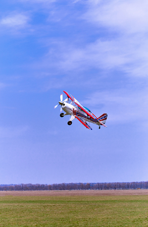 airplane ultralight: A sport turboprop aircraft in flight against the blue sky. Editorial