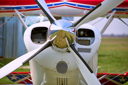 airstrip: Front of the sports plane with a propeller.