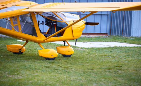 airplane ultralight: An airplane with a propeller ready to fly on a sunny day.