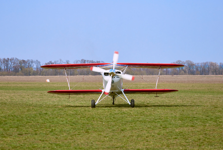 Sports airplane ready for flight on a sunny day.