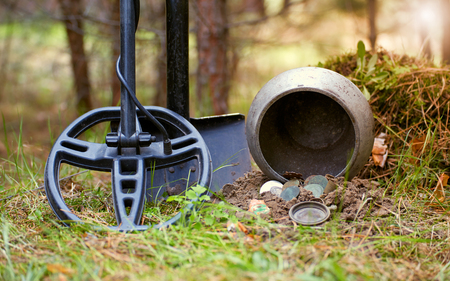 Search for treasure with a metal detector and shovel in the forest. Stock Photo