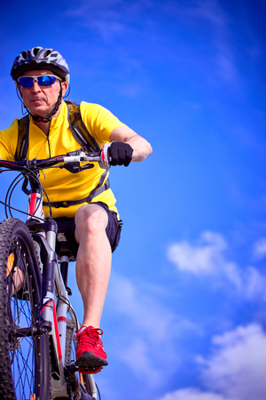 mtb: Cyclist in helmet with mountain bike in the mountains. Stock Photo