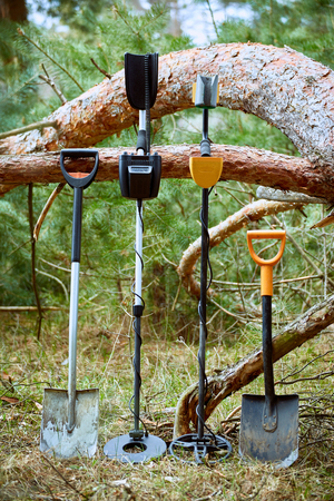hidden success: Search for treasure with a metal detector and shovel in the forest. Stock Photo