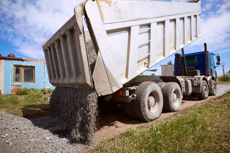 Dumper truck for unloading rubble on the road construction site. Stock Photo - 78283754