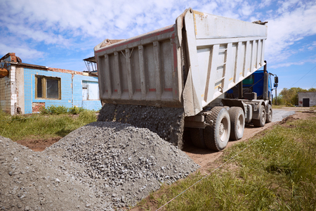 Dumper truck for unloading rubble on the road construction site. Stock Photo - 78896669