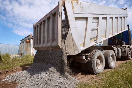 Dumper truck for unloading rubble on the road construction site. Stock Photo