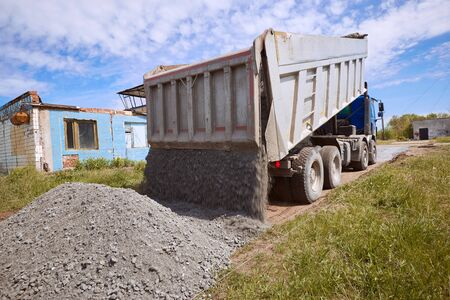 Dumper truck for unloading rubble on the road construction site. Stock Photo - 81461922