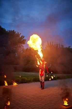Fiery show on the street in the dark.
