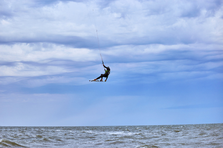 kite surfing: Man riding a kite surfing on the waves in the summer.