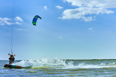 Classes on kitesurfing in the sea against a blue sky. Stock Photo