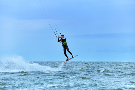 Kite Surfing on waves at sea in summer.
