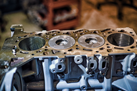 Removal and repair of a turbodiesel engine in a service center.