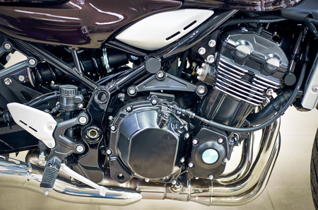 View of the motorcycle with an emphasis on the engine.