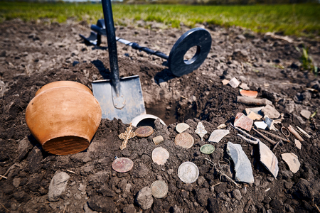 Search for treasure in the countryside in the field. Stock Photo