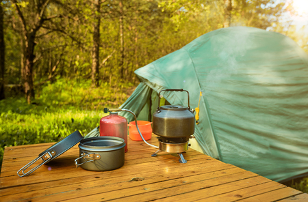 Camping in the forest on a beautiful meadow in spring. Stock Photo