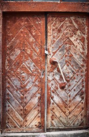Old traditional wooden doors in the countryside in summer.