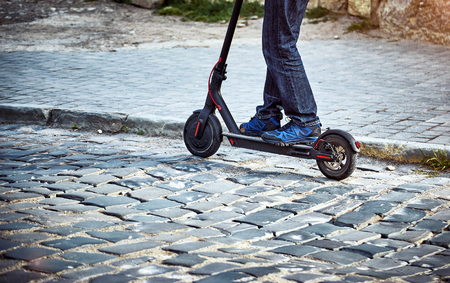 Using an electric scooter as a vehicle in rural areas.