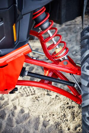 Elements of the suspension on an all-wheel drive ATV. Standard-Bild