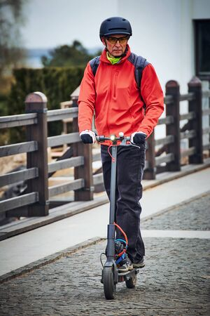 Electric scooter is an economical means of transportation in the city. Stockfoto