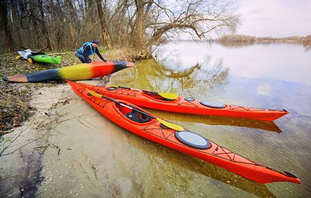 Kayaking along the coast in early spring afternoon. Stock Photo